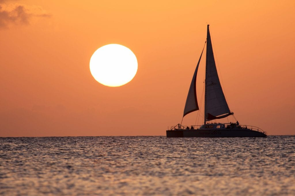 Red Sail Sports at Sunset - Cayman Islands Department of Tourism